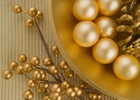 yelow: Gold textured bowl with gold objects Stock Photo