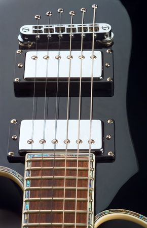 fairly: Guitar curves.  fairly shallow dof, with focal point on front pickup.
