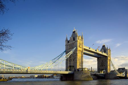 Tower Bridge in London, evening light and blue sky.  Space for copy. photo