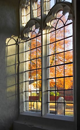 church window: Autumn light through a old church window