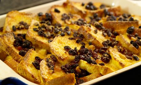 custard: Delicious traditional Bread and Butter pudding with egg custard sugar and dried fruits.  Shallow dof.