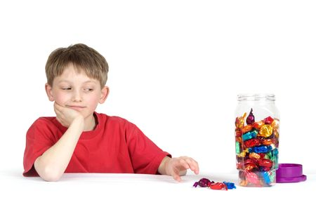 Child reaching for yummy sweets photo