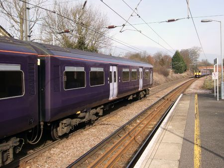 commuter: Commuter trains crossing at a platform in rural England Stock Photo