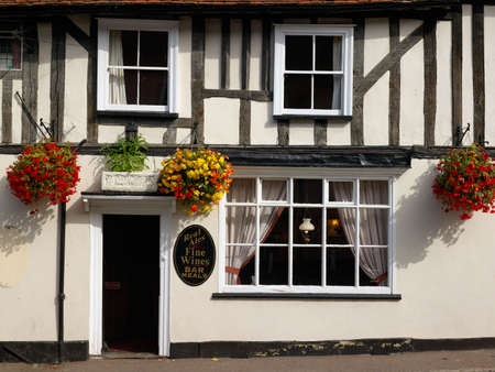 british foods: Traditional od=ld English pub external detail, with hanging baskets and wrm welcome