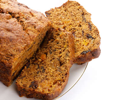 loaf of bread: Fresh Ginger and fruit bread on white