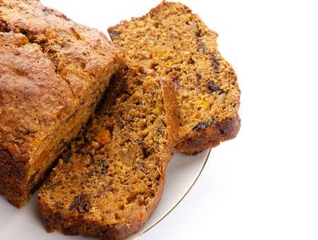 baked bread: Fresh Ginger and fruit bread on white