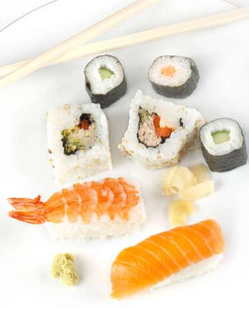 highkey: A Japanese inspired Sushi meal with Nigiri prawnm smoked salmon, Californian rolls Wasabi paste and Hosomaki vegetable rolls.  High-key. Stock Photo