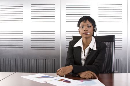 Young businesswoman with microphone headset in a modern office setting photo
