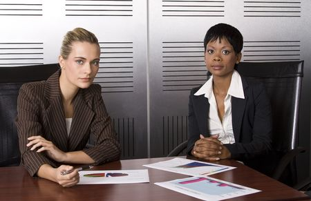 Multi-racial business team working within an office with sales graphs photo