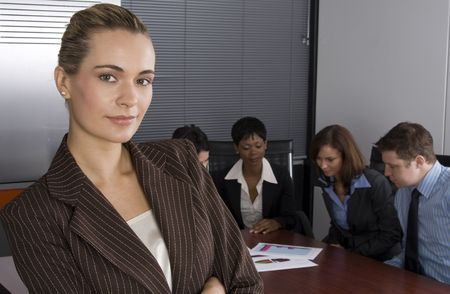 Multi-racial business team sitting around an office boardroom  photo