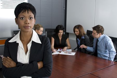 affirmative: Multi-racial business team sitting around an office boardroom  Stock Photo