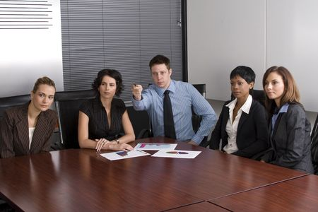 Multi-racial business team sitting around an office boardroom  Stock Photo - 2011144