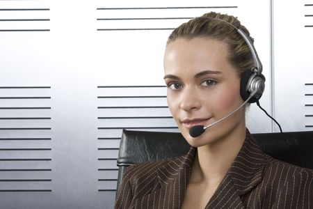 Young businesswoman with microphone headset Stock Photo - 2010486