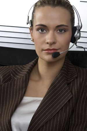 Young attractive blond call center agent talking on the headset in a modern office setting Stock Photo - 2250788