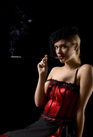 prostitute: Attractive cabaret girl smoking a sigarette with an extension