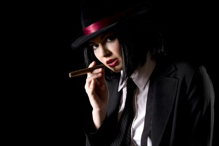 gangster background: Attractive brunette dressed as a new york gangster with black background