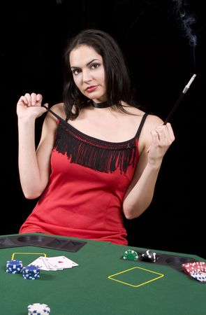 Attractive poker playing woman with and sigarette in extension looking at the camera photo