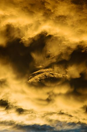A passenger airplane flying past storm clouds at sunset. photo