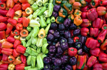 A rainbow of fresh sweet peppers at the farmers market.