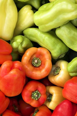 Orange, yellow, red and green sweet peppers at the farmers market. Stock Photo