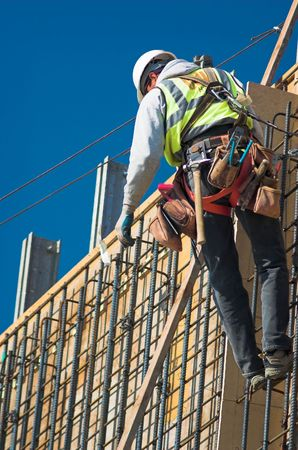 A construction worker on a high wall Stock Photo