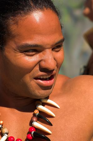 Muscular young Polynesian man wearing a claw necklace Stock Photo
