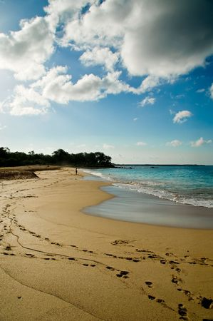 Image of a Maui beach with footprints in the sand and tropical clouds above Stock Photo - 2115799