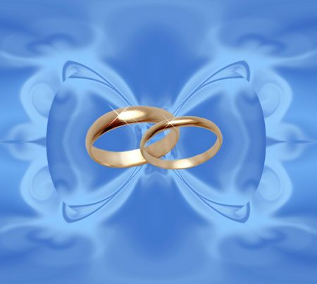 Abstract blue background with wedding rings