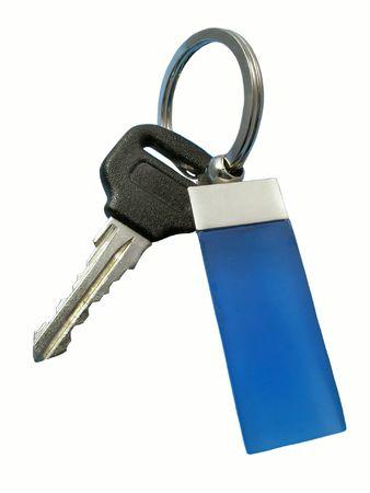 Key with blue decoration. Isolated on white photo