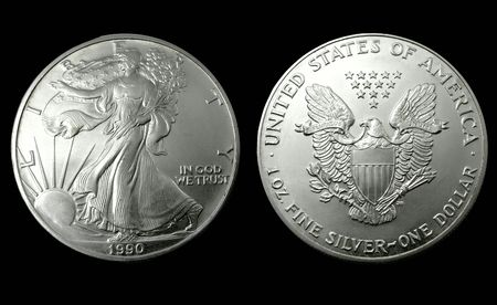 argentum: American silver dollar of 1990. Isolated on black Stock Photo