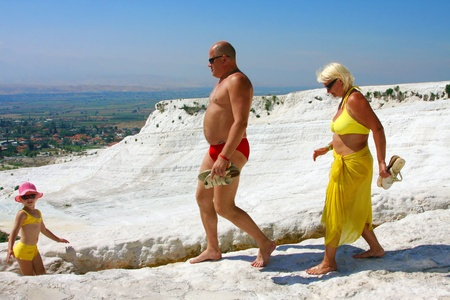 Travertine pools and terraces, tourists in Pamukkale, Turkey - September 3, 2009 Stock Photo - 12849437