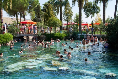 thermal spring: People swiming in ancient pool of queen Cleopatra in a Hierapolis, On September, 17th, 2009, Pamukkale resort, ancient Hierapolis, Turkey Editorial