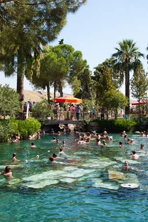 People swiming in ancient pool of queen Cleopatra in a Hierapolis, On September, 17th, 2009, Pamukkale resort, ancient Hierapolis, Turkey Stock Photo - 13257008