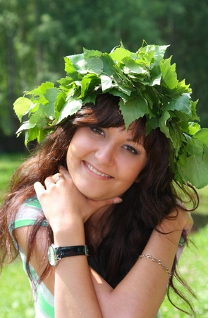 Portrait of the beautiful young woman in Wreath from birch leaves photo