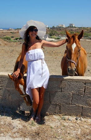 Happy young woman with horses photo