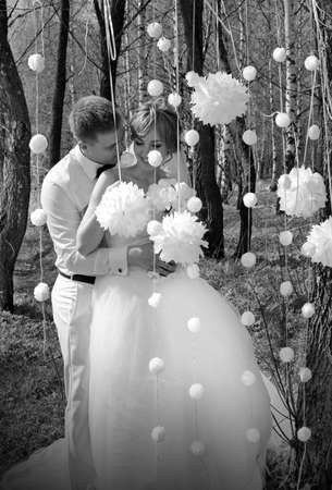 Bride and groom in wedding spring day photo