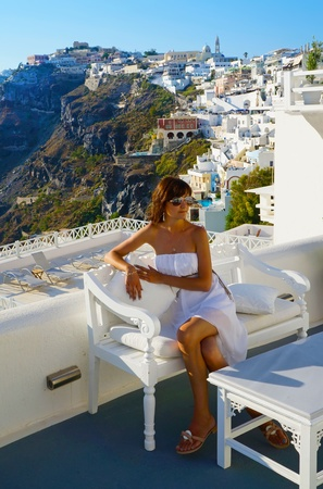 thira: Beautiful woman on holidays, Santorini Thira town view Stock Photo