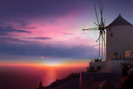 traditional windmill: Beautiful Oia village in Santorini island  Greece