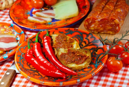 calabria:  The south Italy, Calabria, locale  food -  soft sausage nduja, peper, tomato, cheese