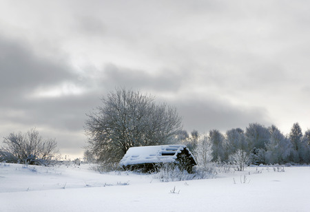 Old wooden church in country, winter season photo