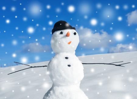 Snowman and pine christmas tree, winter scene photo
