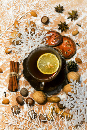 Christmas tea , spicery, nuts and decorations with snow photo