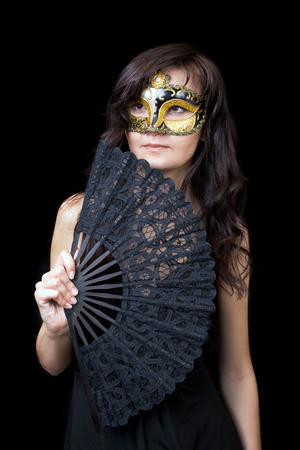 Pretty young woman in Carnival Venetian mask photo