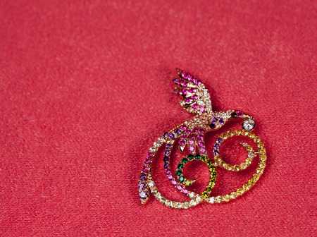 jewelle: Golden jewelry brooch bird on pink background for valentines cards