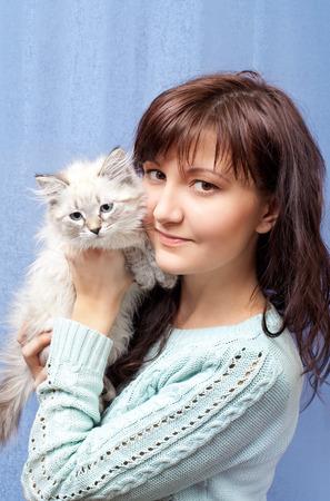 nevsky: Charming young woman with sibirsky nevsky kitten