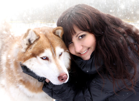 Young woman and dogs siberian husky on snow, winter   photo