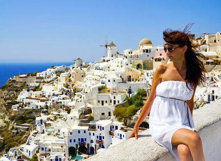 aegean sea: Young woman on holidays, Santorini Oia town  Stock Photo