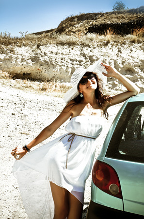 touring car:  Happy woman on travel on the car in Greece