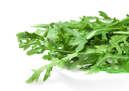 fresher: Food  ingredients - salad green ruccola (arugulla)  isolated over white background Stock Photo