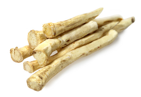 fresher: Food  ingredients - root of horseradish over white background Stock Photo